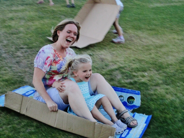 Sledding on a cardboard box